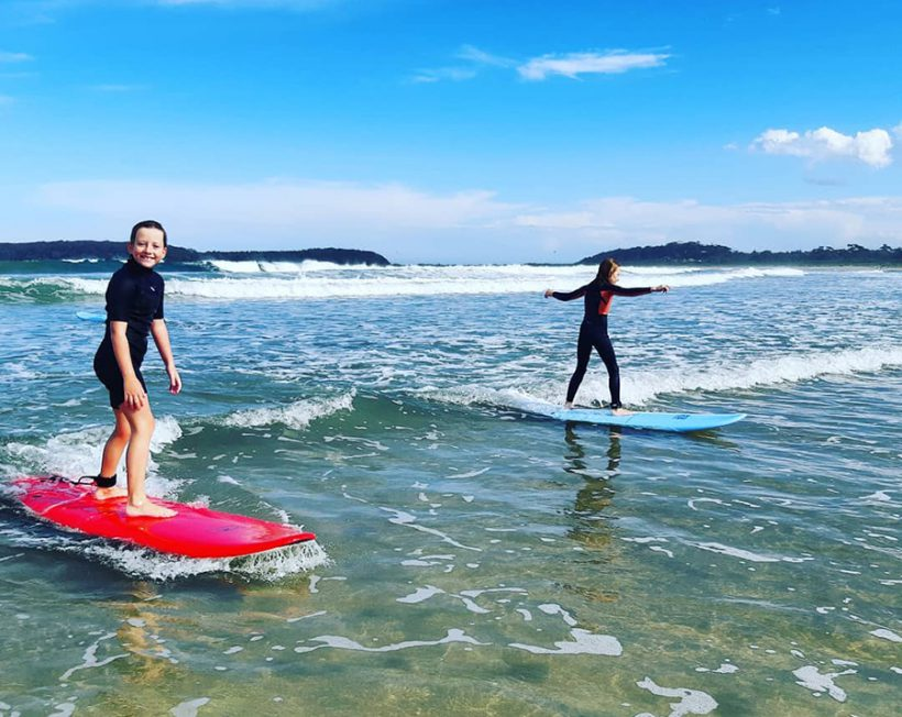 people surfing lessons
